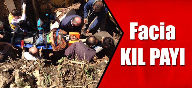Düzköy'de çalışırken üzerine toprak kayan işçi yaralandı.