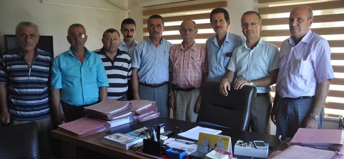 turkiye-muhtarlar-dernegi-akcaabat-subesi-yonetim-kurulu,-akcaabat-adliyesi'ne-gerceklestirdigi-ziyarette-gorevine-yeni-atanan-cumhuriyet-savcisi-suat-salih-tabakci'ya.jpg